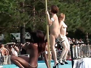 Naked Ladies Are Posing And Taunting On The Stage, In Front Of Many Excited People